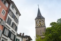 Cityscape of old Zurich, Switzerland. Clock tower. Of St. Peter church stock images