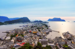 Cityscape of Oleson on water. Norway. Panoramic aerial view on Oleson port city, with stands on stilts on the sea water  in the middle of mountain islands Royalty Free Stock Photos