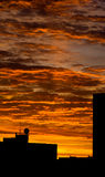 Cityscape orange sky dawn silhouette Royalty Free Stock Photography