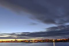 Cityscape over the river with a big cloud Stock Images