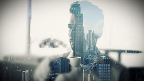 Cityscape overlay on businessman drinking coffee stock video footage