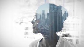 Cityscape overlay on thinking businesswoman stock video footage