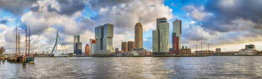 Cityscape, panorama, banner - view of the moored sailboats on a background of skyscrapers district Feijenoord city of Rotterdam an Royalty Free Stock Photography