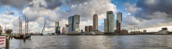 Cityscape, panorama, banner - view of the moored sailboats on a background of skyscrapers district Feijenoord city of Rotterdam an Stock Images
