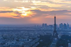 Cityscape of paris in the dusk with eiffel tower. The Eiffel Tower is a wrought iron lattice tower on the Champ de Mars in Paris, France. It is named after the Royalty Free Stock Images