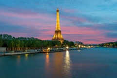 Cityscape of Paris, France with Eiffel Tower at night on . The Eiffel tower is the most visited monument of France with about 6 m. Illion visitors every year Royalty Free Stock Image