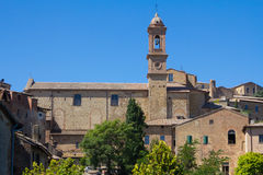 Cityscape of Pienza, Tuscany. Cityscape of Pienza with the tower of the church and blue sky, Tuscany, Italy Stock Image