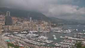 Cityscape of the Port of Monaco. Cityscape of th Port of Monaco, Monte Carlo, with Yachts, High Rise Buildings on the French Riviera stock footage