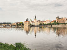 Cityscape of Prague, capital of Czechia, with river Vltava and Charles Bridge Royalty Free Stock Images