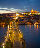 Cityscape of Prague with Castle and Charles Bridge at night Stock Photos