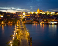 Cityscape of Prague with Castle and Charles Bridge at night Royalty Free Stock Photo
