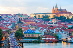 Cityscape of Prague with Castle and Charles Bridge at sunset Royalty Free Stock Images
