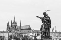 Cityscape of Prague in monochrome with statue of the Charles bridge in the foreground Stock Images