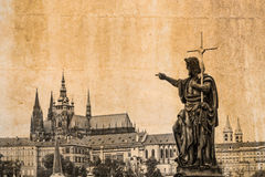 Cityscape of Prague in vintage look with statue of the Charles bridge in the foreground Royalty Free Stock Photos