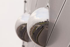 Cityscape reflection in metal sphere facade detail Royalty Free Stock Photo
