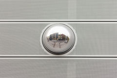 Cityscape reflection in metal sphere facade detail Stock Photos