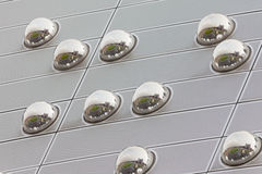 Cityscape reflection in metal sphere facade detail Stock Photo