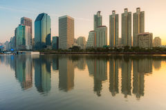 Cityscape with reflection during sunrise Stock Image