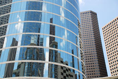 Cityscape Reflections. Downtown Houston skyscrapers and reflections against a blue sky Royalty Free Stock Photo