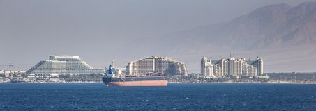 Eilat, Israel Cityscape. Cityscape of resorts in Port of Eilat, Israel in the middle east. Tanker and merchant ships are a common site in the foreground Stock Image