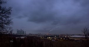 Cityscape with river and park at foreground and movement of the clouds at dusk stock footage