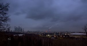 Cityscape with river and park at foreground and movement of the clouds at dusk stock video footage