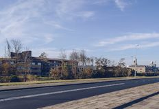 Cityscape and road of Den Helder. Cityscape and empty road of Den Helder at warm october day royalty free stock photos