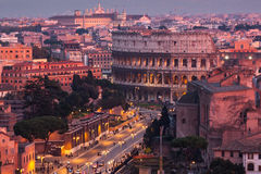 Cityscape of Rome at dusk with Colosseum Royalty Free Stock Images