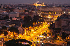 Cityscape of Rome at nitgh with Colosseum Royalty Free Stock Photography