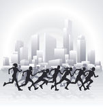 Cityscape runners. Runners running in an urban city with a cityscape skyline in the background Royalty Free Stock Photo