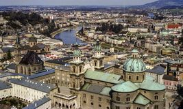 Landscape of Salzburg city and Salzach River. View of Salzburg`s baroque architecture, cathedral, with the Salzach River meandering through the city; bridges Royalty Free Stock Photos