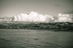 Cityscape of san san sebastian, concha bay in black and white sepia, basque country, spain. View on cityscape of san san sebastian, concha bay in black and white Royalty Free Stock Images