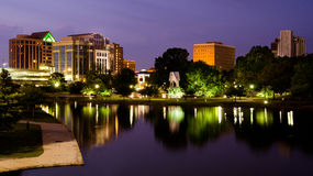 Cityscape scene of downtown Huntsville, Alabama. From Big Spring Park after sunset Royalty Free Stock Photos