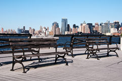 Cityscape scenic picture with park bench. Photo cityscape scenic picture with park bench to view Stock Photos
