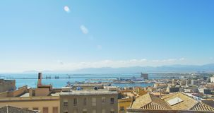 Cityscape and sea long focus Cagliari, Italy panning shot stock footage