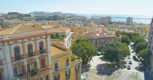 Cityscape and sea long focus Cagliari, Italy panning shot stock video