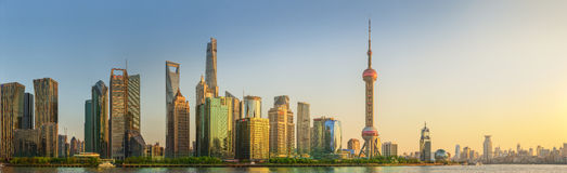 Cityscape of Shanghai and Huangpu River on sunset, beautiful reflection on skyscrapers, China Stock Image