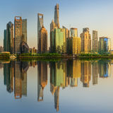 Cityscape of Shanghai and Huangpu River on sunset, beautiful reflection on skyscrapers, China Stock Photo