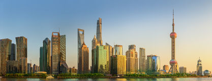 Cityscape of Shanghai and Huangpu River on sunset, beautiful reflection on skyscrapers, China Stock Photography