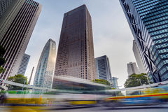 Cityscape in Shinjuku District, Tokyo, Japan. Cityscape in Shinjuku district with traffic in blurred motion and skyscrapers on the background Royalty Free Stock Photography