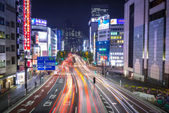 Cityscape of Shinjuku district with traffic lights on the street of Tokyo, Japan Stock Photo