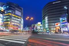 Cityscape of Shinjuku district with traffic lights on the street of Tokyo. Tokyo, Japan - November 14, 2016: Cityscape of Shinjuku district with traffic lights Stock Photo