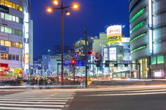 Cityscape of Shinjuku district with traffic lights on the street of Tokyo. Tokyo, Japan - November 14, 2016: Cityscape of Shinjuku district with traffic lights Royalty Free Stock Images