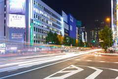 Cityscape of Shinjuku district with traffic lights on the street of Tokyo. Tokyo, Japan - November 14, 2016: Cityscape of Shinjuku district with traffic lights Stock Image