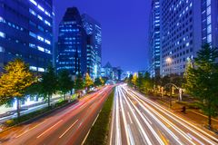 Cityscape of Shinjuku district with traffic lights on the street of Tokyo. Tokyo, Japan - November 14, 2016: Cityscape of Shinjuku district with traffic lights Royalty Free Stock Photography