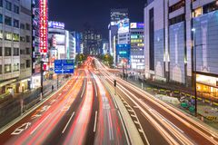 Cityscape of Shinjuku district with traffic lights Royalty Free Stock Photos