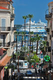 Cityscape with ship and palm trees stock photography