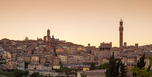 Cityscape of Siena at sunset, Tuscany, Italy Stock Photos