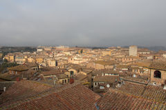 Cityscape of Siena with thick fog on background. Tuscany, Italy. Stock Images