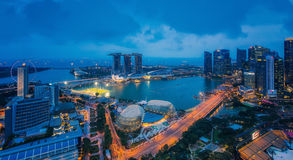 Cityscape of Singapore and Marina bay sand. Area from view of hotel rooftop in night time Royalty Free Stock Photos